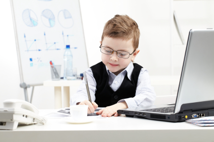 Little businessman busy working with papers